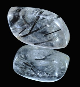 Quartz crystal with rutile crystals